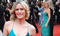 The actress, 51, showed off her toned figure in the plunging turquoise dress at the premier of Loveless.  Robin went braless in the slinky fabric at the 70th annual Film Festival in the south of France.