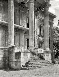 "Iberville Parish, Louisiana. Belle Grove. Vicinity of White Castle. Greek Revival mansion of 75 rooms. Ruinous condition. Built 1857 by John Andrews, who sold it to Stone Ware. Occupied by Ware family until circa 1913. The decaying portico of what was reputedly the largest plantation home in the South."" data-componentType=""MODAL_PIN"
