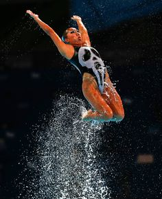 SCREAM Mexico perform their routine in the synchronized swimming team free preliminary event at the FINA Swimming World Championships in Barcelona, Spain, Tuesday, July 23, 2013 (AP Photo/Emilio Morenatti)
