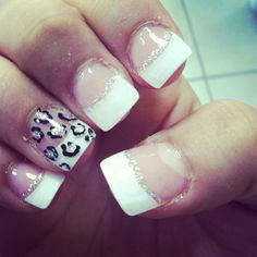 Classic white french tip with cheetah print on the ring finger