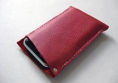 Perfectly sized for your iPhone, this case is crafted from gorgeous, supple, classic red leather. The case features a raw leather edge and corner rivet detail.  From Fog + Foundry. $30