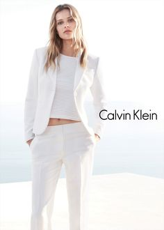 Wearing chic and minimal basics, Edita Vilkeviciute fronts the spring-summer 2015 campaign from Calvin Klein White Label. The new season offers relaxed suiting, casual separates as well as modern dresses. Posing alongside Tyson Ballou, Edita looks stylish in these images captured by Daniel Jackson with styling by Tony Irvine. Related