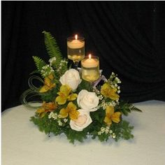 Elegant Wedding Reception Centerpiece. Tutorial for how to set the candle glasses on floral foam, so this could be done with fresh or silk florals.