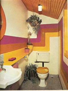 1970s: Cloakroom with ever-popular pine wood panelled ceiling, pine toilet seat, spider plants and stylised wall design.