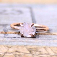 """Alright ladies. I know we just posted this, but by Popular Demand we are offering $50 off on this ring (Rose gold or Silver with Raw Cut Rose Quartz) for the month of March! The coupon code you need is """"QUARTZRING"""". The link to our page is in our Bio. Message us if you have a hard time finding the ring on our Etsy Page! happy Buying!! . . . . #woodring #obsidian #silver #sterlingsilver #jewelry #jewellery #sterlingssilvershop #cooljewelry #unique #engagement  #turquoise #turquoisering…"""