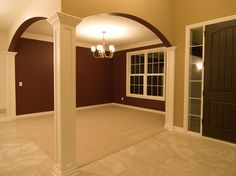 Square column and arched entryways- beautiful