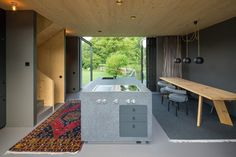 This small wooden house in Bavaria, Germany, was recently completed by Arnhard & Eck. The wooden house is only 13 feet wide; the kitchen, dining, living Small Wooden House, Narrow House, Forest Cottage, Colorful Apartment, Mountain Designs, Vacation Home Rentals, Contemporary Interior Design, Smart Design, Interiores Design
