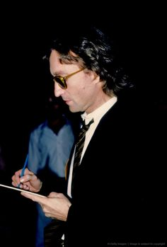 John Lennon signs an autograph outside of the Times Square recording studio 'The Hit Factory' before a recording session of his final album 'Double Fanasy' in August 1980 in New York City, New York. (Photo by Vinnie Zuffante/Michael Ochs Archives/Getty Images)