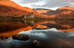 Kilchurn Castle is a ruined 15th and 17th century structure on a rocky peninsula at the northeastern end of Loch Awe, in Argyll and Bute, Scotland