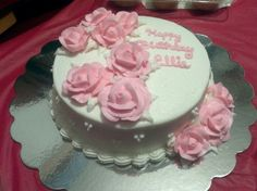 Birthday cake with pink buttercream roses