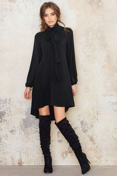 We heart you, so we have to bring you this beauty! The Chiffon Tie Neck Dress comes in black fabric with turtle neck, 2 golden closing buttons, a tie for a more fashionable look and features long sleeves with drawstring at the ends. Style this with a hat and high heels!