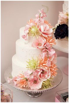 We love this super cute floral wedding cake! Go to www.suppliesforcakes.com to get all you need to master the sugar flower technique!