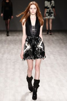 Tux vest built into mini print dress worn with slouchy suede boots. Yes, that's a look to work for Fall from Jill Stuart.