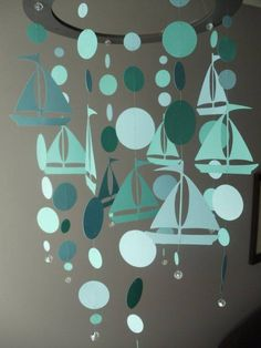 sailboat paper mobile idea - I want shades of navy blue and light blue MODED Bahamian regatta boats, flag colours, cardboard, glitter Hanging Mobile, Mobiles, Diy Paper, Paper Art, Paper Crafts, Mobil Origami, Baby Mädchen Mobile, Diy And Crafts, Nautical Wedding