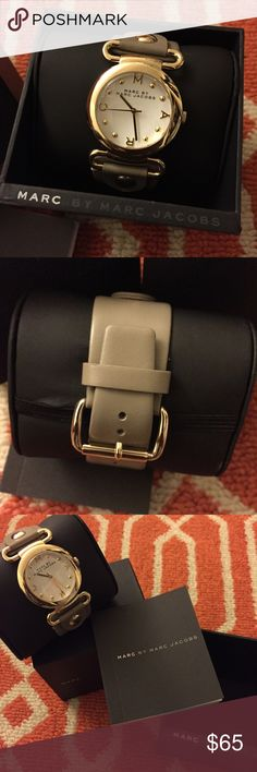 Marc Jacobs Watch Women This Marc Jacobs watch is brand new and has never been worn. The protective cover is still on the front face of the watch. The packaging includes the original box, watch pillow and instructors manual. Marc Jacobs Jewelry
