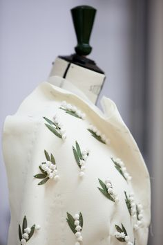 The house of Dior's most recent haute couture collection revisited the founder's lucky talisman and favorite flower: the lily-of-the-valley.
