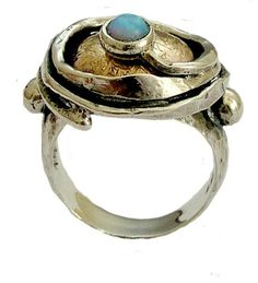 oxidized Sterling silver and hammered yellow gold statement ring with blue opal gemstone - A place under the sun.