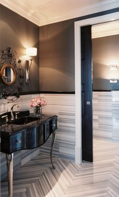 A Glamorous Home Influenced by 1940's Design | Interior Design by Jamie Herzlinger of Jamie Herzlinger Interiors | Photography by Neil Landino | Modern Sanctuary | Bathroom | Powder Room | Glamorous Powder Room | Mirror | Glamorous Mirror | Lighting | Tile | Bathroom Tile