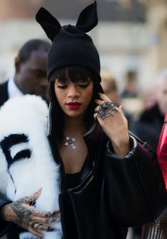 Rihanna edgy/rock look.love the spider web ring and the beanie with bunny ears<3