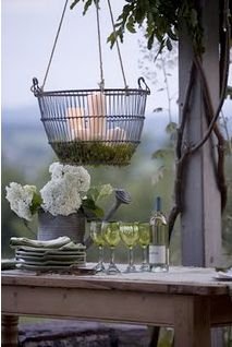Outdoor elegance. Moss-bottom basket and candles.