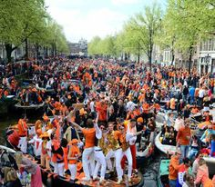 King's Day Amsterdam Holland - The city is crowded on the 27th April 2016 with people dressed in orange to celebrate this national holiday. Live music, parties, markets and orange-pride everywhere: King's day! Discover more unique travel inspiration on www.mapiac.com !