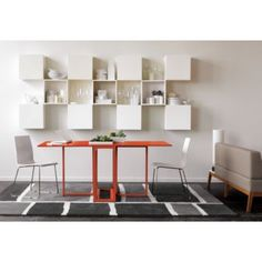 Flip n Dine Table from CB2... a modern version of the gate-leg table; Great for small spaces.