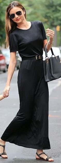 Who made  Miranda Kerr's black tote handbag, short sleeve maxi dress, belt, aviator sunglasses, gold jewelry, and flat studded sandals that she wore in New York?
