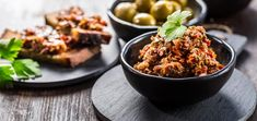 Olive tapenade is a lemony, garlicky spread or dip that makes for the perfect dinner party appetizer. And it only takes 10 minutes to make! Dinner Party Appetizers, Pitted Olives, Tapenade, Raw Vegan Recipes, A Food, Food Processor Recipes, Dip, Homemade, Healthy