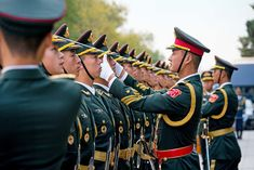 Chinese officers use a string to align the caps of members of an honor guard before the start of a welcome ceremony for US President Donald Trump and first lady Melania Trump in Beijing, on Thursday, November Honor Guard, First Lady Melania Trump, Working People, Human Condition, Photos Of The Week, Us Presidents, Ny Times, Donald Trump, Captain Hat