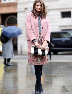 Natalie In Burberry and Miu Miu. On the street in London.