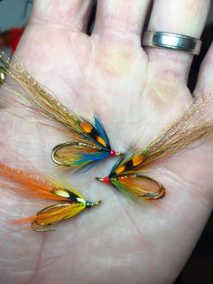 Spring in mind. Flamethrowers, 1 orange flamethrower and the other 2 are WG colours with blue front hackles. Sz8 gold patriots. By Jay Loftus