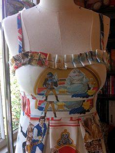 Star Wars dress--I know Dan has some Return of the Jedi bedspreads somewhere. ;-)