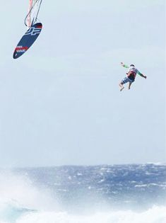 Crazy windsurfing jump by Ricardo C. at Ho'okipa, Maui