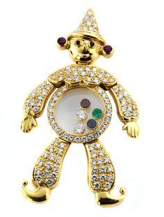 """Länge: ca. 4,8 cm. Gewicht: ca. 11,7 g. GG 750. Signiert """"Chopard Geneve 6577"""". Beweglich montierter großer """"Happy Diamond""""-Harlekinanhänger mit..."""