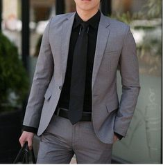 He's in a dark gray suit w/ a black button down and black tie that made him look so sexy.