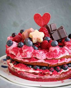 Valentine's Day means a gorgeous, delish vegan cake! :)💕☺Berrylicious Beetroot cake layered with a vegan butter and coconut creme and blueberries, topped with more butter creme, raspberries, blueberries, pomegranate, some dark chocolate and marzipan stars and of course a glittering heart by @frei_style. <3 Mmmyummy!