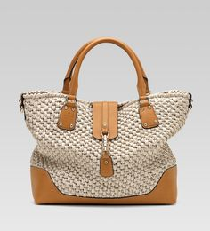 """I love the summery goodness of Gucci's 'Santa Monica"""" large tote with embossed Gucci trademark.  I love it in the off-white raffia, but I also love it in the navy blue, and delightful tomato red!"""
