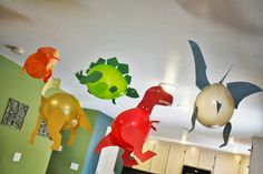 This idea is GENIUS. there aren't detailed instructions on how to recreate these for a dinosaur/Jurassic World themed party (or just for fun, because who wouldn't want a floating Tyrannosaurus Rex hovering about?), but we think you can figure out the DIY instructions just from the picture. You...