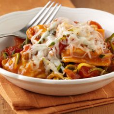 Italian Ravioli Skillet... A special skillet recipe uses beef ravioli in sauce with shredded fresh zucchini and tomatoes topped with cheese