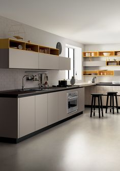 Decorative melamine dresses up this composition in harmony with the most advanced open space furnishing solutions. Severe minimal lines come togheter with warm materials: Genziana Yellow decorative melamine open-fronted units, Flint Grey decorative melamine in the cooking and washing areas and Bright Oak decorative melamine in the working area where the tall units are located. The result is a refined youthful style that embraces comfort and design.