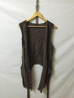 A personal favourite from my Etsy shop https://www.etsy.com/listing/276443152/ys-yohji-yamamoto-sleeveless-hand-knit