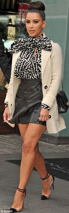 a skirt so short she must hold it down as she walks. it takes attention away from her beautiful face & puts it on her tugging hands.