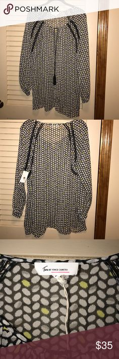 Trendy print blouse by Vince Camuto. NWT. Nice blouse with sheerness but not see through. Print is black and white with a pop of pale yellow color. Drawstring closure at scoop neckline. Wear tucked in or out. With jeans or a skirt. ENJOY FASHION💕 Vince Camuto Tops Blouses