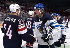 ST. PETERSBURG, RUSSIA - MAY 9: USA's Auston Matthews #34 shakes hands with Finland's Patrik Laine #29 during preliminary round action at the 2016 IIHF Ice Hockey Championship. Finland beat USA 5-0!