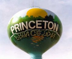 """Princeton, Minnesota, water tower is painted so that the word """"Princeton"""" is reflected under it like a sign next to water."""