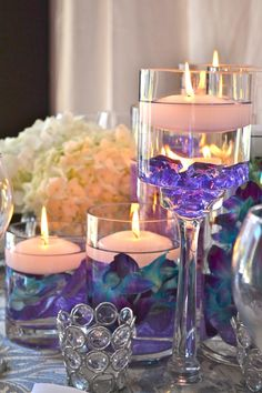 Orchids & Floating Candles Centerpiece by My Dream Fiesta Weddings.