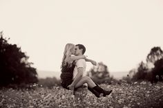 engagement in a flower field, country, cowboy boots. love.