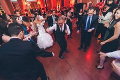 Guests dancing during a wedding reception at the Belvedere Hotel. Captured by NYC wedding photographer Ben Lau.