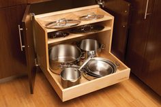 Pull Out Cabinet Storage For Pots and Pans With Ledge Above For Lids