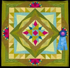 2015 Quilt Expo Quilt Contest, 1st Place, Category 7, Wall Quilts, Machine Quilted Pieced: The Jester's Folly, Margaret Solomon Gunn, Gorham, Me. quiltexpo.com